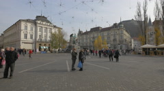 Two women chatting and other people walking in Preseren Square in Ljubljana Stock Footage