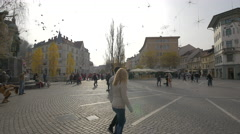 Young and old couples walking in Preseren Square in Ljubljana Stock Footage