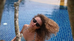 Beautiful Seductive Female in Swimming Pool on Vacation Stock Footage