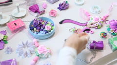 Artist makes jewelry from polymer clay, process. Workshop Stock Footage