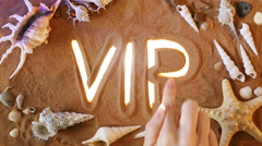 Hand drawing Vip symbol in the sand. Beach background. Top view - stock footage