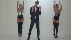 Man is singing to the music with two girls dancing on  background - stock footage