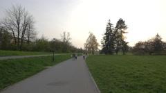 Biking, walking and running on an alley in Tivoli park, Ljubljana Stock Footage