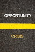 Antonym concept of CRISIS versus OPPORTUNITY Stock Photos