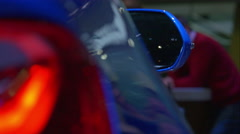 4K abstract shot of a blue car - red light & mirror - stock footage