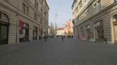 People walking between two similar buildings on Stritarjeva street in Ljubljana Stock Footage