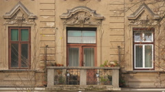 Balcony and windows of an old building on Petkovskovo street in Ljubljana Stock Footage