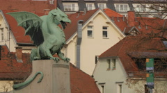 Dragon sculpture on the Dragon Bridge in Ljubljana Stock Footage
