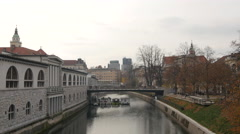 Riverside view with the Central Market building in Ljubljana Stock Footage