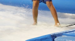 Boy Surfer Enjoying Surfing in Aquapark - stock footage