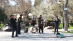 Anonymous musicians in a park Stock Footage