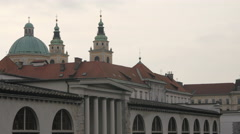 Red roof, tiles, dome and steeples in Ljubljana Stock Footage