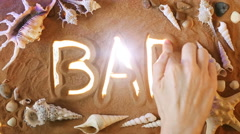 Hand drawing Bar symbol in the sand. Beach background. Top view Stock Footage