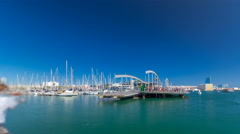 Rambla de Mar wooden walkway timelapse over Port Vell in the city of Barcelona Stock Footage