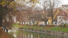 Men relaxing and fishing in Ljubljanica River in Ljubljana Stock Footage