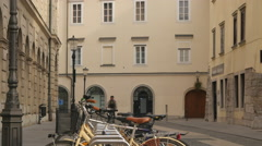 Man riding the bike in the old city center of Ljubljana Stock Footage