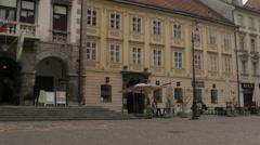 People walking in Town Square pan left view in Ljubljana Stock Footage