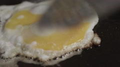 Turning on a fried egg Stock Footage