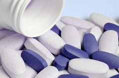 Drug pills spilled from the tube - stock photo