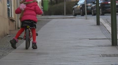 Girl is Learning to Ride Bike by City Square Opole Poland City Day Child is Stock Footage