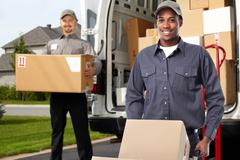 Delivery man near shipping truck. Stock Photos