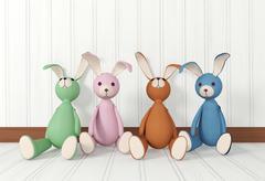Group of rabbit dolls sitting - stock illustration