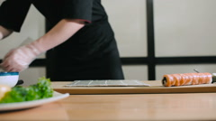 Sushi master spreads rice on nori Stock Footage