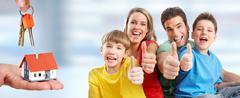 Happy family and little house. Stock Photos