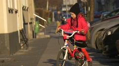 Child is Riding the Bicycle by City Street Opole Poland City Day Child is Stock Footage