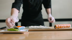 Sushi master cooking sushi roll Stock Footage