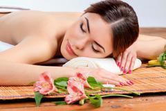 Beautiful young woman at a spa salon Stock Photos