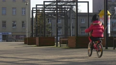 Father is Walking Behind a Daughter Riding Bike Dad in Red Jacket Spends the Stock Footage