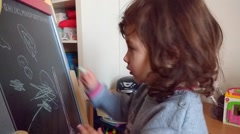 Lovely child is singing and drawing Stock Footage