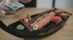 Final touch in the preparation of sushi rolls Stock Footage