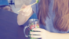 Young girl eating vegetable salad . Stock Footage