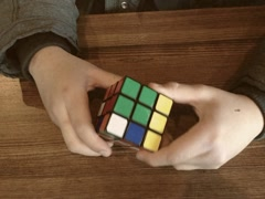 Boy Playing With a Rubik's Cube 8mm Stock Video Stock Footage