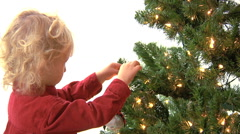 Little Boy Decorating Christmas Tree Stock Footage
