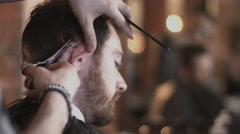 Young Adult Male having haircut in barbershop - stock footage