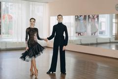 Professional dancers dancing in ballroom. Latin. Stock Photos