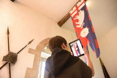 History student photographing Richard III banner, Bolton Castle, 14th century Stock Photos