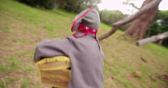 Dressing up Pirate child running away with treasure chest - stock footage