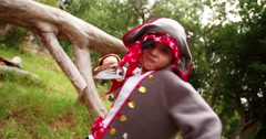 Fun Pirate boy playfully fighting with his saber in park - stock footage