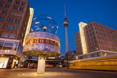 Speeding tram at Berlin Alexanderplatz and World Clock Stock Photos