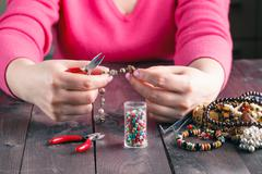 coil,beads and tools for needlework - stock photo