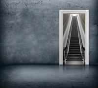 Concrete room with access to escalator through the doorway - stock illustration