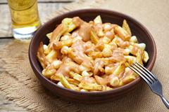 Poutine Quebec traditional meal with fries, curd cheese and gravy - stock photo
