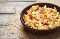 Poutine Canadian homemade traditional fast food meal with fries, curd - stock photo