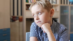 Cute blond teenage boy study feeling sleepy - stock footage