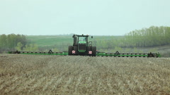 Sowing of sweet corn by using contemporary agricultural machinery - stock footage