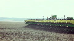 Sowing of sweet corn by using contemporary agricultural machinery Stock Footage